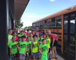 The Hub Club kids loading the bus for an adventure.