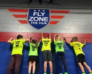 Adventure Camp kids posing at the Fly Zone.