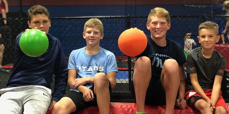 Dodgeball players posing and smiling.