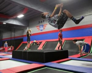 Teenager doing a flip at the Fly Zone.